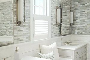 Bathroom with walls of tile