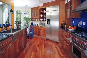 Kitchen with matching cabinets and floors