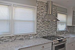 Kitchen with mosaic tile backsplashes