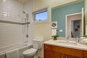 Bathroom with missing tile walls or tile walls being removed