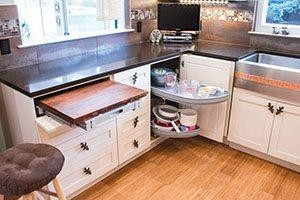 Kitchen with cabinets featuring a column pullout