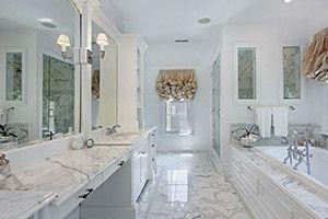 bathroom with countertops made with granite or marble