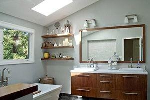 bathroom with floating shelves and wall cabinets