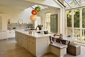 kitchen with booth seats behind the cabinets
