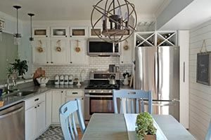 kitchen with white tall cabinets up to the ceiling