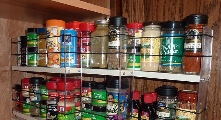 spice rack attached to cabinet door