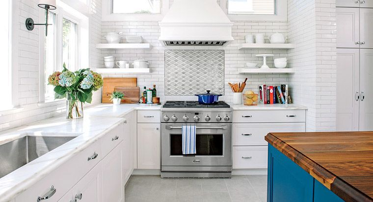 white or natural finish wall cabinets with dark base cabinets