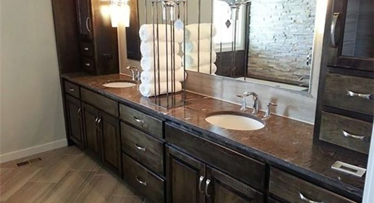 bathroom with beveled edge vanity