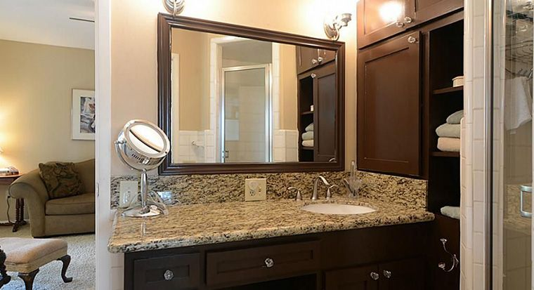 bathroom with bullnose edge vanity