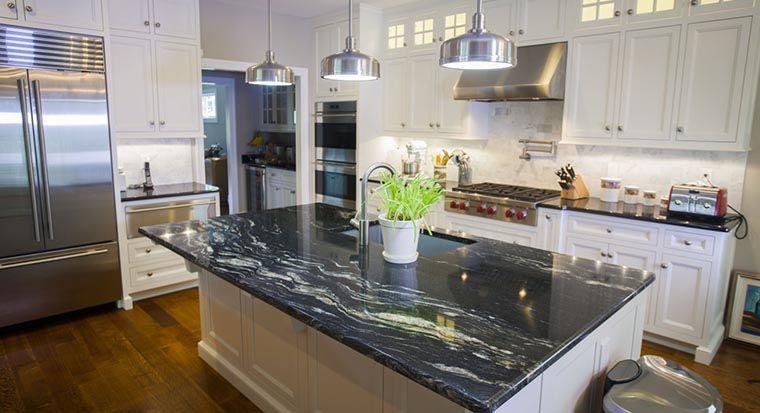white kitchen with dark granite countertops