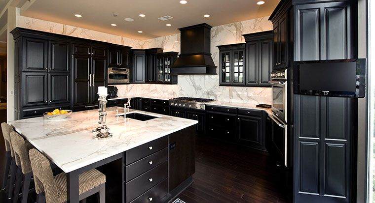 black kitchen with marble counters