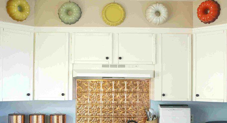 artwork or vintage items along kitchen cabinet-ceiling gap