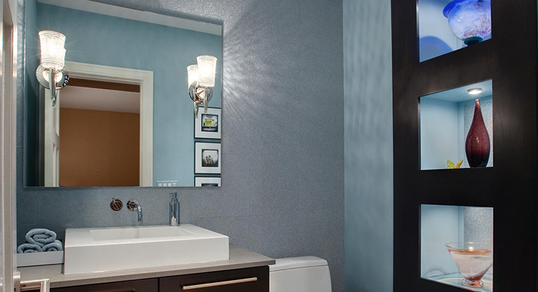 white half-bath with mirrors