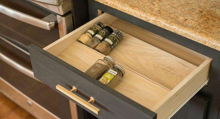 spice bottles arranged in top drawer
