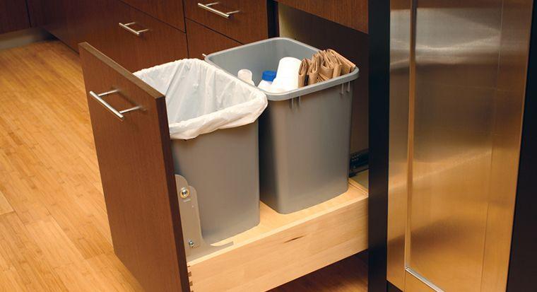 trash bin hidden next to the sink